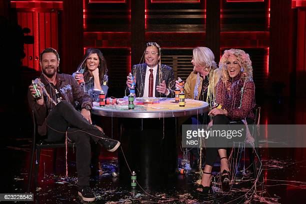 Karen Fairchild Jimi Westbrook Phillip Sweet and Kimberly Schlapman of musical guest Little Big Town play Stranger Strings with host Jimmy Fallon on...