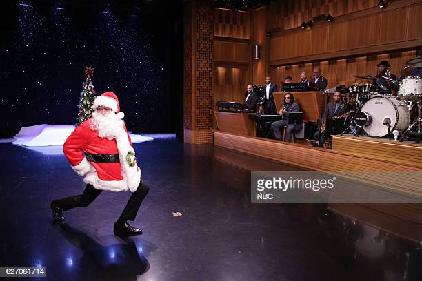 Host Jimmy Fallon dressed as Santa Claus with The Roots during 'Suggestion Box' on November 30 2016