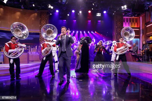 The Rutgers Tuba Band Darth Vader Chewbacca Storm Troopers Salsa Dancers and host Jimmy Fallon during the 'May the 4th' skit on May 4 2017