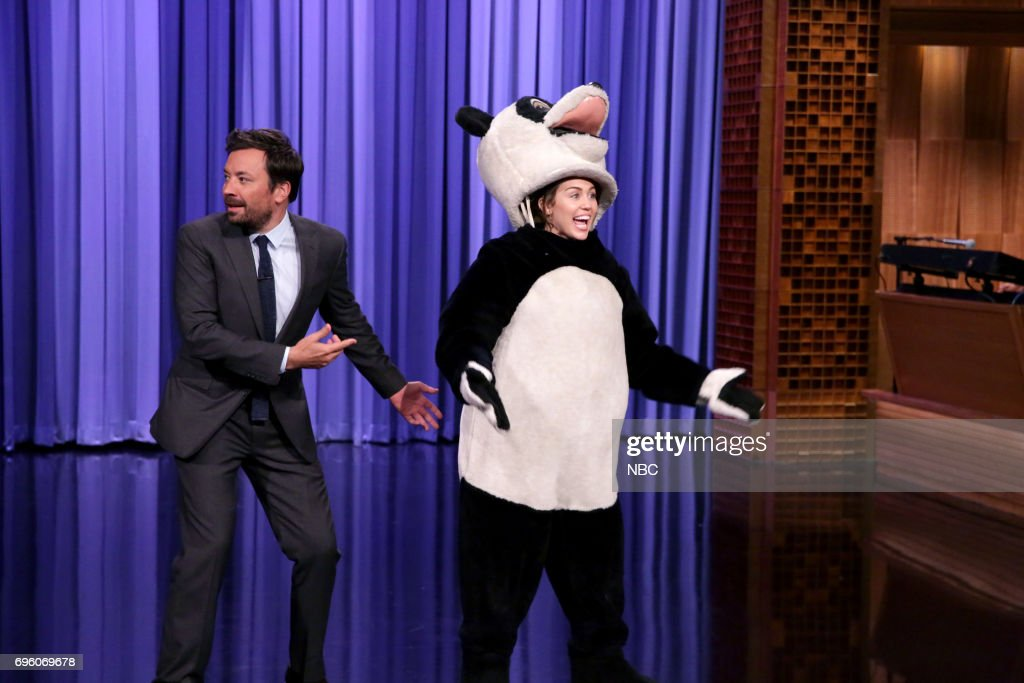 Host Jimmy Fallon with co-host Miley Cyrus as Hashtag the Panda during the opening monologue on June 14, 2017 --