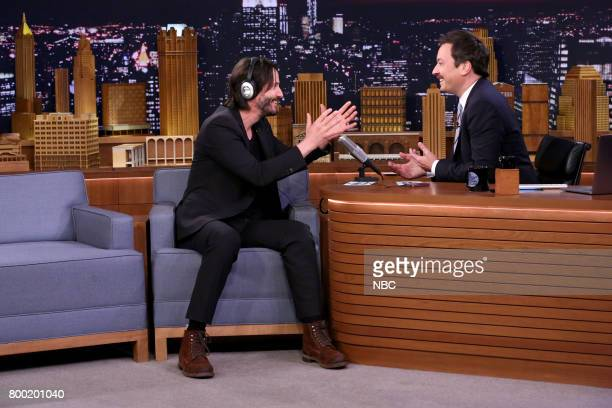 Actor Keanu Reeves with host Jimmy Fallon during 'Whisper Challenge' an interview on June 23 2017