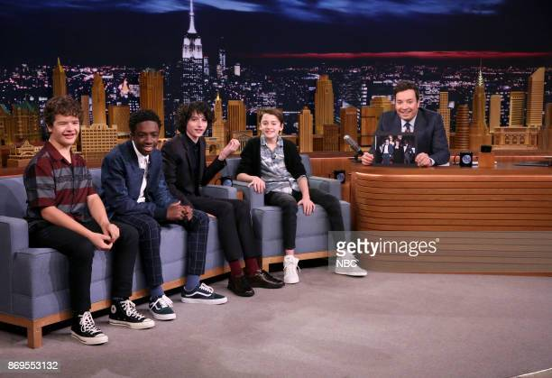 Gaten Matarazzo Caleb McLaughlin Finn Wolfhard and Noah Schnapp from the cast of Stranger Things with host Jimmy Fallon during an interview on...