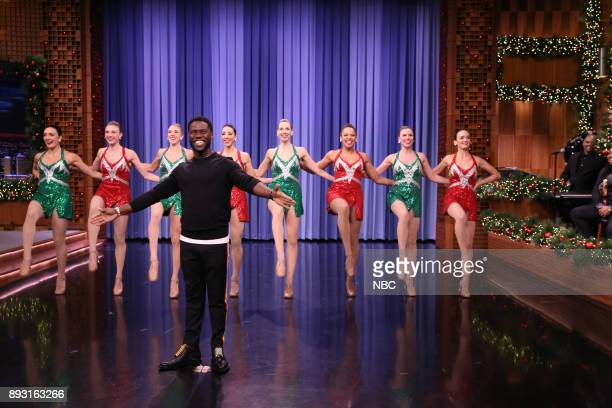 Comedian/Actor Kevin Hart enters with the Rockettes during an interview on December 14 2017