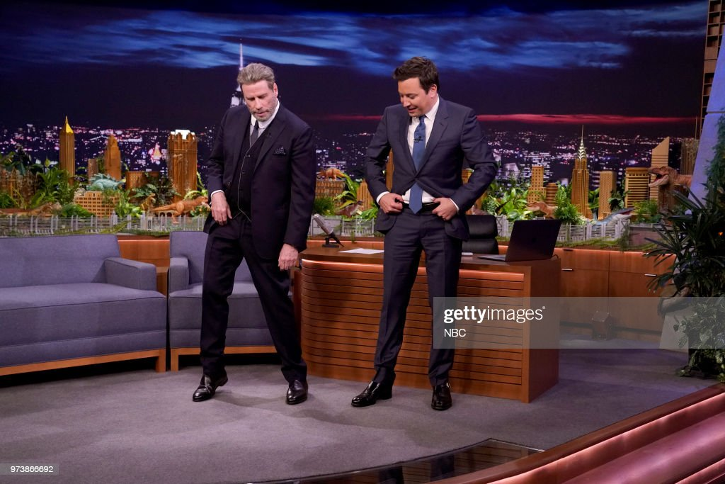 Actor John Travolta teaches host Jimmy Fallon dance moves from 'Grease' on June 13, 2018 --