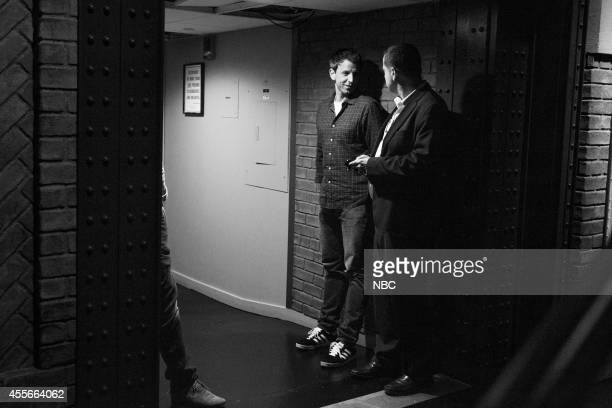 Episode 089 -- Pictured: Host Seth Meyers talk with executive producer, Mike Shoemaker backstage on September 2, 2014 --