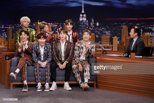 Episode 0931 -- Pictured: Band BTS during an interview with host Jimmy Fallon on September 25, 2018 --