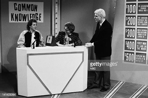 LIVE Episode 1 Air Date Pictured Dana Carvey as Kyle Nofner Nora Dunn as Jeane Kirkpatrick during the 'Common Knowledge' skit on October 17 1987...