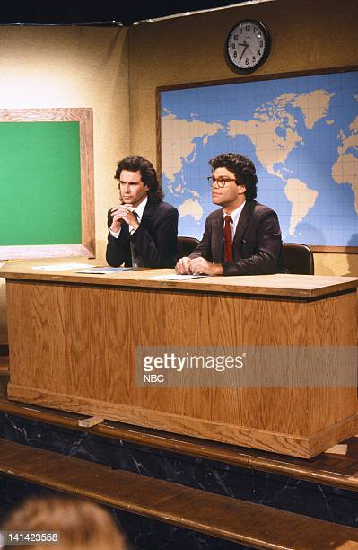 LIVE Episode 1 Air Date Pictured Dennis Miller Al Franken during 'Weekend Update' on October 17 1987 Photo by Al Levine/NBCU Photo Bank