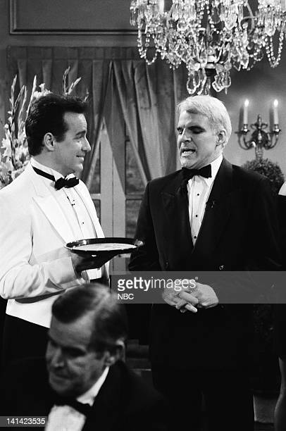 LIVE Episode 1 Air Date Pictured Phil Hartman as Gregory the waiter Steve Martin as James Bond during the Bullets Aren't Cheap skit on October 17...