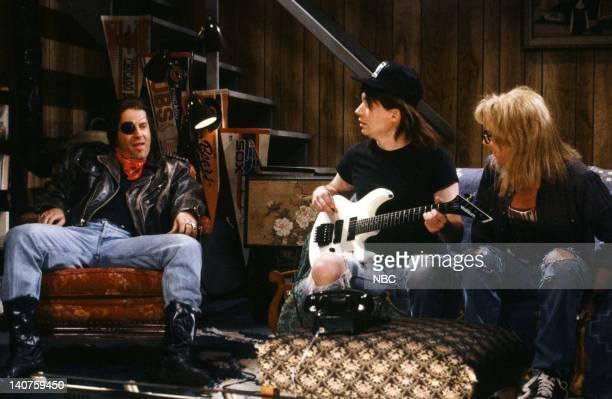 Bruce Willis as Rick Mike Myers as Wayne Campbell Dana Carvey as Garth Algar during the 'Wayne's World' skit on September 30 1989 Photo by NBC/NBCU...