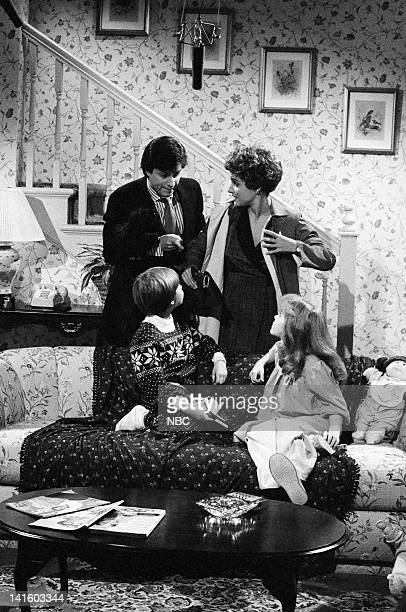 Gary Kroeger as Father Frederick Koehler as Brian Julia LouisDreyfus as Mother during the 'Grandpa Howard' skit on October 6 1984