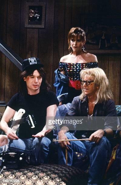Mike Myers as Wayne Campbell Jan Hooks as Nancy Simmons Dana Carvey as Garth Algar during the 'Wayne's World' skit on September 30 1989 Photo by...