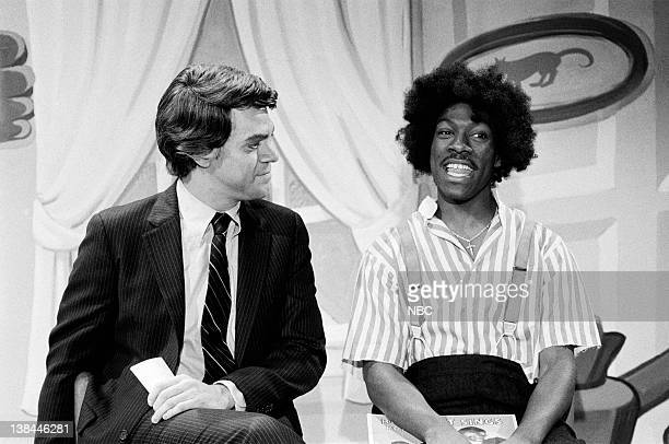 """Episode 10 -- Aired -- Pictured: Joe Piscopo as Tom Snyder and Eddie Murphy as Buckwheat during """"The Uncle Tom Show"""" skit on January 30, 1982."""