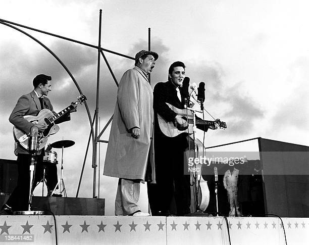 SHOW Episode 10 aired Pictured Guitarist Scotty Moore host Milton Berle musician Elvis Presley on the deck of the USS Hancock aircraft carrier