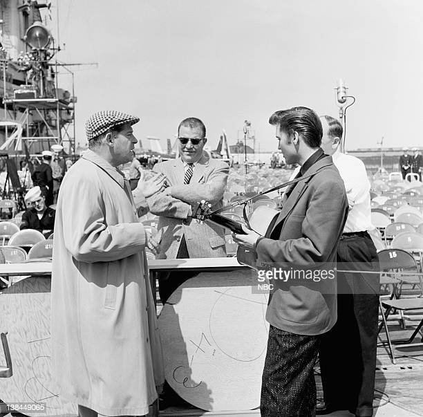 SHOW Episode 10 aired Pictured Host Milton Berle unknown musician Elvis Presley Presley's manager on the deck of the USS Hancock aircraft carrier