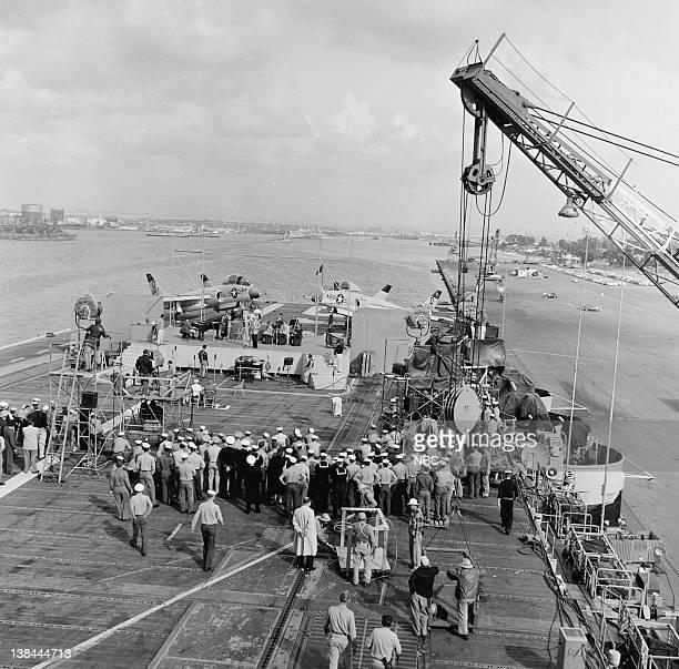 Crew of the USS Hancock gather to watch Elvis Presley perform