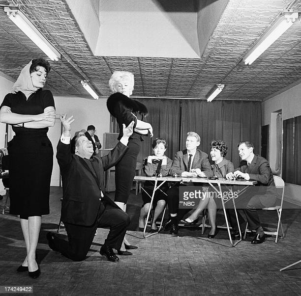 Regular comedic performers Marilyn Hanold Michael Enserro panelists Elaine May Mike Nichols Dorothy Loudon guest panelist Orson Bean during rehearsal...