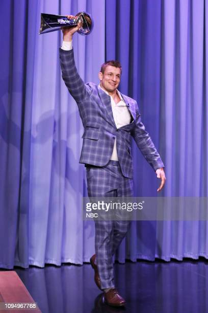 Football player Rob Gronkowski arrives to the show carrying the Vince Lombardi Trophy on February 6 2019