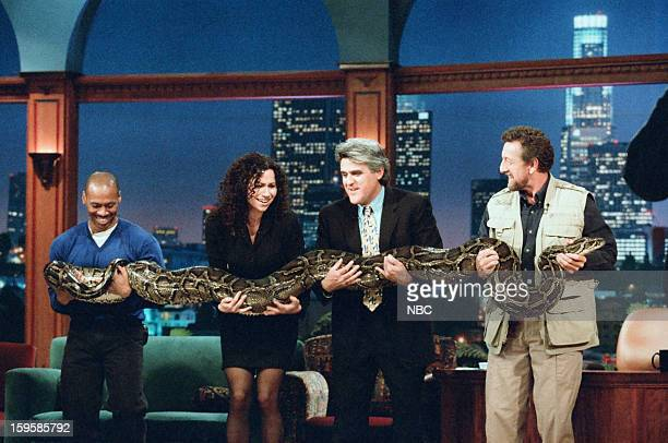 Bandleader Kevin Eubanks actress Minnie Driver host Jay Leno reptile expert Clylde Peeling onstage October 25 1996