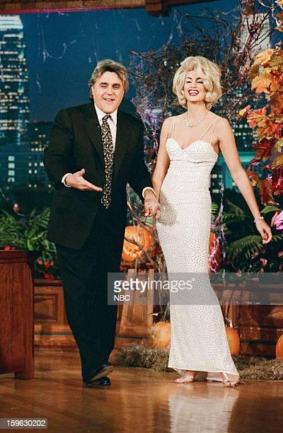 Episode 1022 -- Pictured: Host Jay Leno greets model Cindy Crawford on October 31, 1996 --
