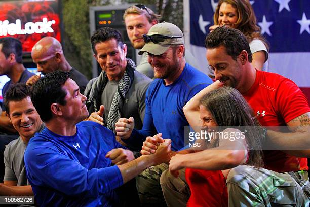 Front row Nick Lachey Dean Cain Picabo Street Middle row Dale Comstock Tom Stroup Chris Kyle Brent Gleeson Back row Grady Powell Eve Torres