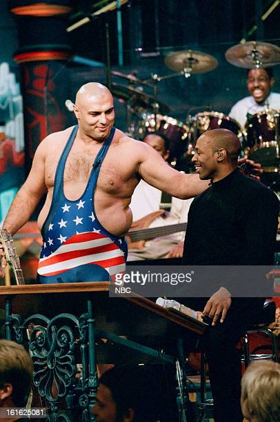 """Episode 1043 -- Pictured: Wrestler Matt Ghaffari with Tonight Show Band leader Kevin Eubanks during the """"Massage in Audience"""" skit on December 2,..."""