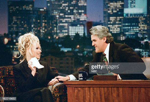 Actress Pamela Anderson with host Jay Leno during an interview on December 9 1996