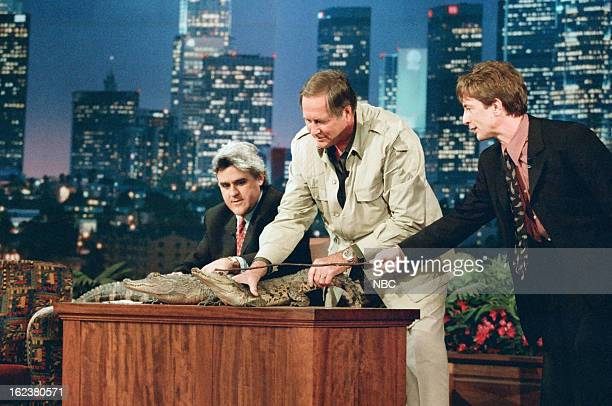 Host Jay Leno with zoologist Jim Fowler and actor Martin Short during an interview on December 13 1996