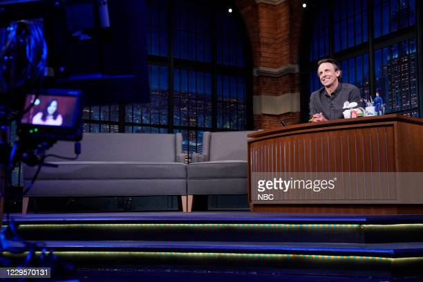 Episode 1064A -- Pictured: Host Seth Meyers talks with singer Demi Lovato on November 10, 2020 --