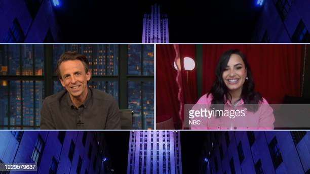Episode 1064A -- Pictured in this screen grab: Host Seth Meyers talks with singer Demi Lovato on November 10, 2020 --