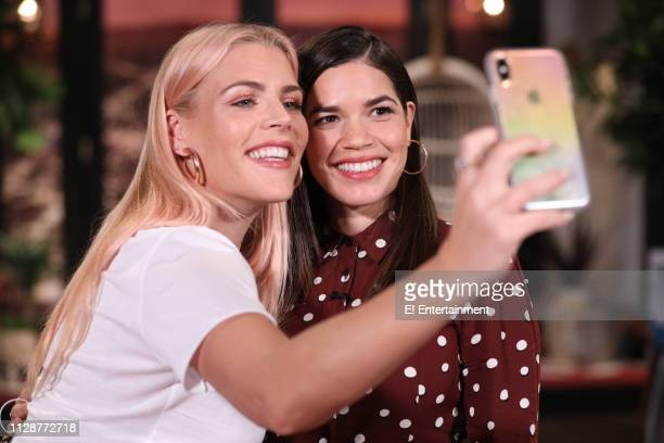 Host Busy Philipps and guest America Ferrera on the set of Busy Tonight