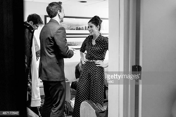 Host Seth Meyers talks with comedian Sarah Silverman backstage on September 25 2014