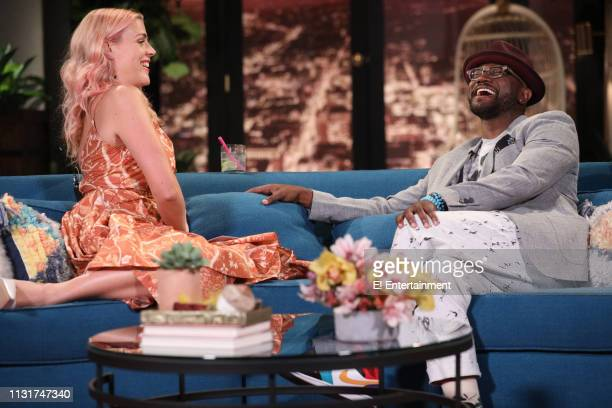 Host Busy Philipps and guest Taye Diggs on the set of Busy Tonight