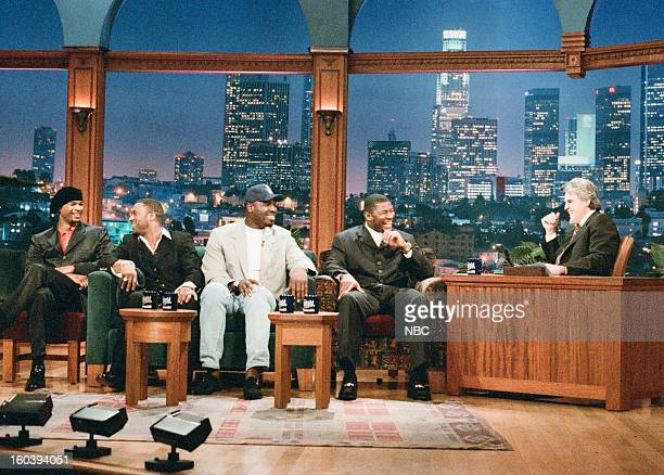 Actor Damon Wayans NFL football players Andre Rison Edgar Bennett Sean Jones during an interview with host Jay Leno on January 28 1997