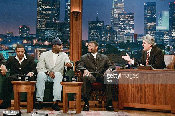 NFL football players Andre Rison Edgar Bennett Sean Jones during an interview with host Jay Leno on January 28 1997