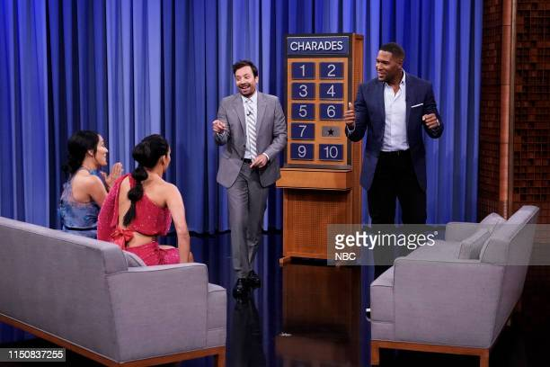 Former professional wrestlers Brie Bella and Nikki Bella with host Jimmy Fallon and former football player Michael Strahan during Charades on June 19...