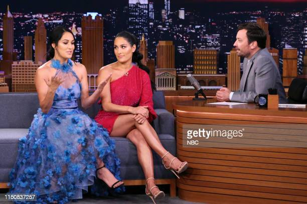 Former professional wrestlers Brie Bella and Nikki Bella during an interview with host Jimmy Fallon on June 19 2019