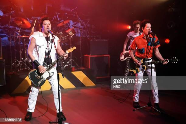 "Episode 1099 -- Pictured: Host Jimmy Fallon and actor Kevin Bacon as The Clash during ""First Drafts of Rock - 'Should I Stay Or Should I Go'"" on July..."