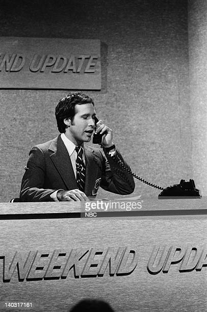 LIVE Episode 11 Air Date Pictured Chevy Chase during Weekend Update on January 24 1976 Photo by NBCU Photo Bank