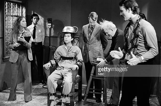 Laraine Newman as Madeline Mitchell Laurance as guard Tom Schiller as Dean Slydell Dan Aykroyd as Roy Groomis Phil Hyms Bill Murray as Jim during the...
