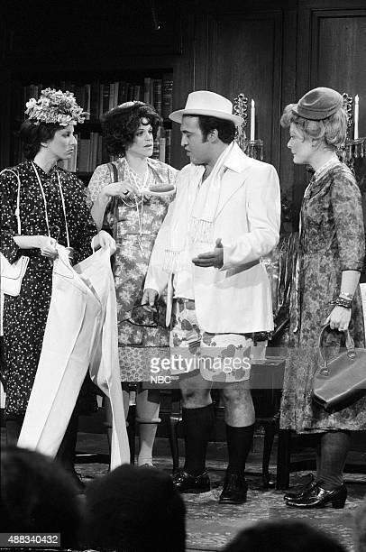 Laraine Newman Gilda Radner John Belushi as Truman Capote Jane Curtin as old woman during the 'Endings' skit on February 18 1978