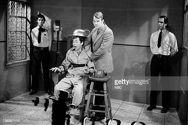 Mitchell Laurance as guard Tom Schiller as Dean Slydell Dan Aykroyd as Roy Groomis Neil Levy as guard during the 'TV Execution' skit on January 15...