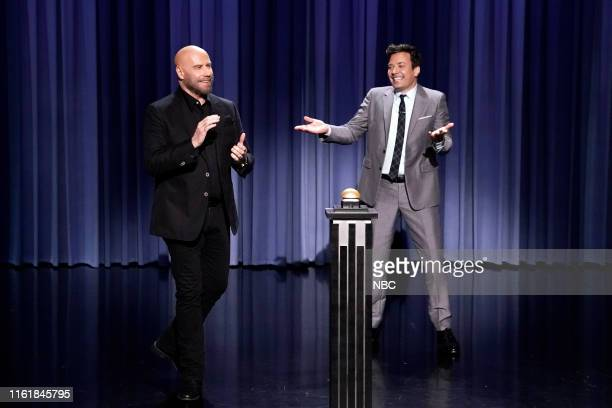 "Episode 1109 -- Pictured: Actor John Travolta and host Jimmy Fallon during ""Travolt-Off"" on August 15, 2019 --"