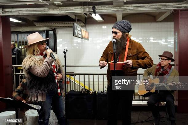 Musician Alanis Morissette and host Jimmy Fallon during Subway Busking on December 4 2019