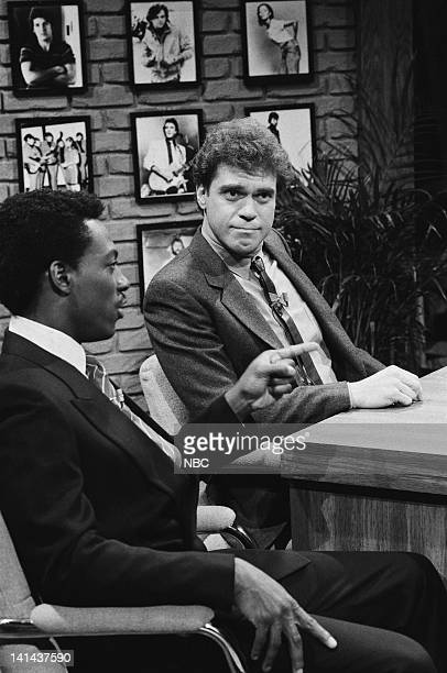 Episode 12 -- Pictured: Eddie Murphy as Clarence Walker, Joe Piscopo as Buzzy Free during the 'Rock & Roll and then some' skit on February 11, 1984...