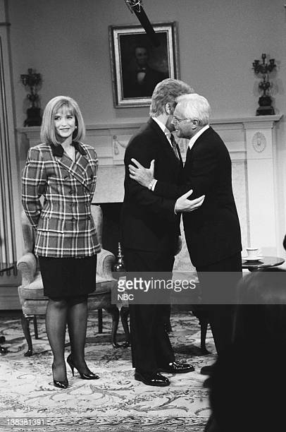 Jan Hooks as Hillary Clinton Phil Hartman as Bill Clinton Giorgio Armani as Giuliano Amato during the 'Open White House' skit on February 6 1993