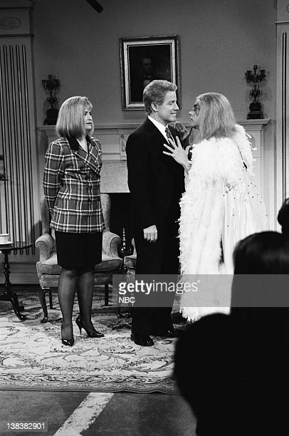 Episode 12 -- Pictured: Jan Hooks as Hillary Clinton, Phil Hartman as Bill Clinton, Chris Farley as wrestler during the 'Open White House' skit on...