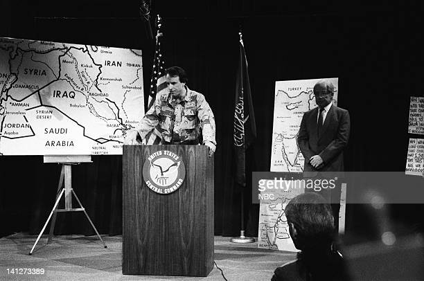 Episode 12 -- Pictured: Kevin Nealon as Lt. Colonel William Pierson, Phil Hartman as Dick Cheney during the 'Military Briefing' skit on February 9,...