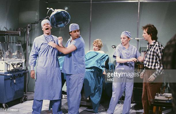 Tom Hanks as doctor Jon Lovitz as doctor Victoria Jackson as mother Dana Carvey as father during the 'Delivery Room' skit on February 20 1988 Photo...