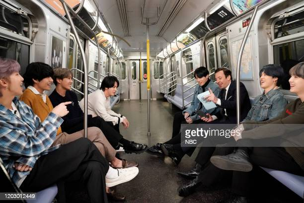 RM V JHope Jin and Jungkook of BTS and host Jimmy Fallon with Jimin and SUGA of BTS during an interview on the New York Subway on February 24 2020